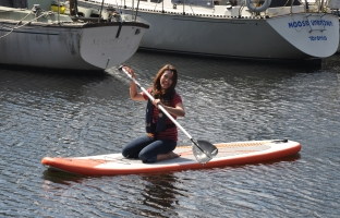 Maxine Kneeling Safely on Her Stand Up Paddleboard