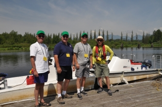 Bill, Bob, Darcy and Mike Pose for the Camera in Front of the Referee Boats